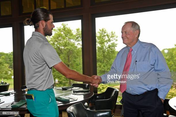 Tournament host Jack Nicklaus visits with Curtis Luck of Australia in the clubhouse during the third round of the Memorial Tournament presented by...