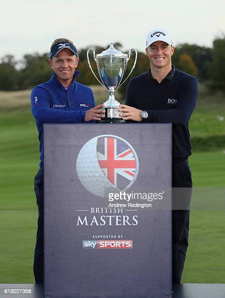 Tournament host Luke Donald of and Champion Alex Noren of Sweden pose with the trophy following the fourth round of the British Masters at The Grove...