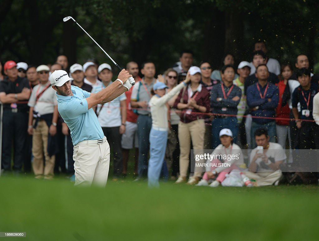 Tournament leader Dustin Johnson of the US watches fairway shot on the 11th hole during day three of the WGC-HSBC Champions tournament at the Shanghai Sheshan International Golf Club on November 2, 2013. AFP PHOTO/Mark RALSTON