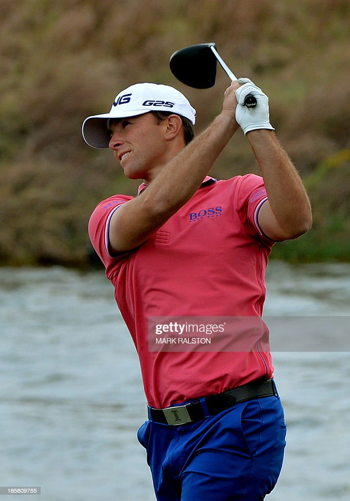 Tournament leader Luke Guthrie of the US tees off at the 9th hole during the second day of the BMW Shanghai Masters golf tournament at the Lake Malaren Golf Club in Shanghai on October 25, 2013. Guthrie finished on 8 under par at the 7 million USD event which is being held for the second time at the Lake Malaren Golf Club. AFP PHOTO/Mark RALSTON