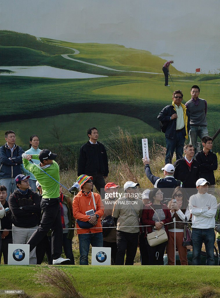 Tournament leader Luke Guthrie of the US (front L) tees off at the 9th hole during the third day of the BMW Shanghai Masters golf tournament at the Lake Malaren Golf Club in Shanghai on October 26, 2013. Guthrie finished the second day on 8 under par at the 7 million USD event which is being held for the second time at the Lake Malaren Golf Club. AFP PHOTO/Mark RALSTON