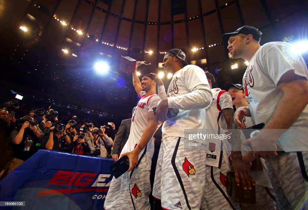 TOurnament Most Outstanding player Peyton Siva #3 and Wayne Blackshear #20 of the Louisville Cardinals celebrate after they won 78-61 against the Syracuse Orange during the final of the Big East Men's Basketball Tournament at Madison Square Garden on March 16, 2013 in New York City.