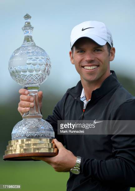Tournament Winner Paul Casey of England lifts the trophy at the conclusion of the Irish Open at Carton House Golf Club on June 30 2013 in Maynooth...