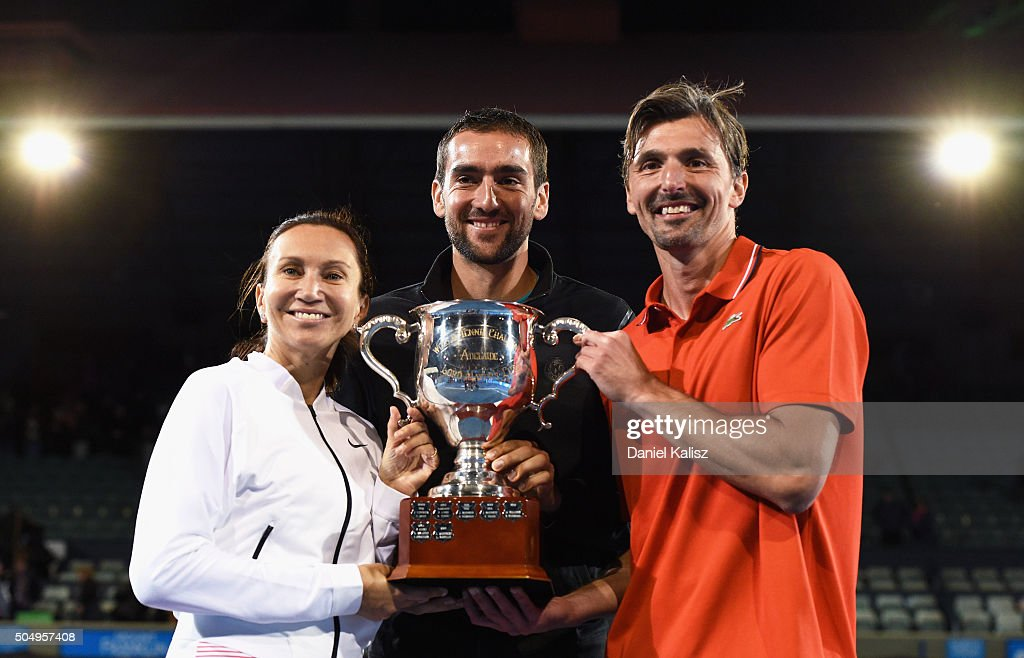 Tournament winners Iva Majoli of Croatia Marin Cilic of Croatia and Goran Ivanisevic of Croatia of Team Ivanisevic pose for a photo with the trophy...
