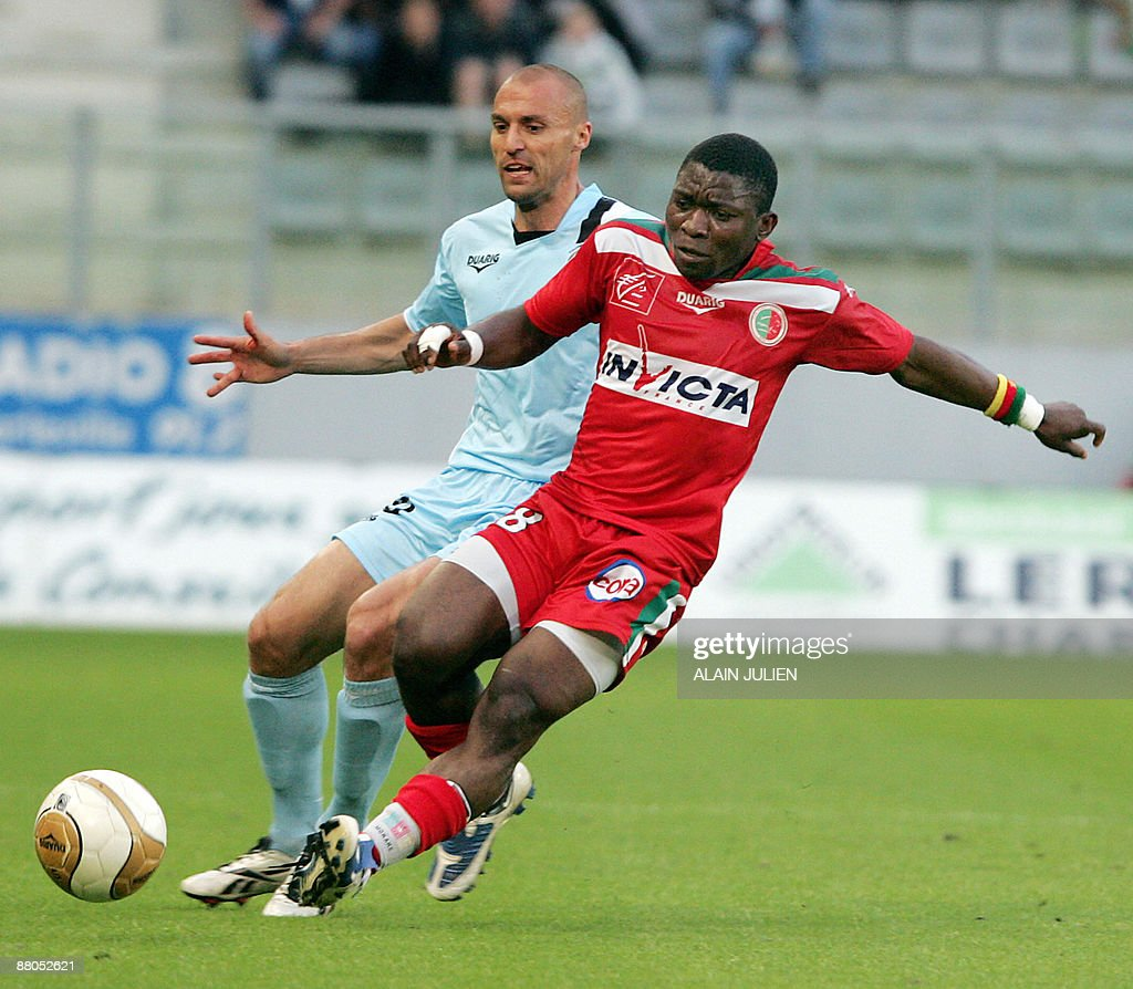 Tours' Alexandre Dujeux vies with Sedan's Marcus Mokake during their French L2 football match Tours vs Sedan at the Louis Dugaugez stadium on May 29...