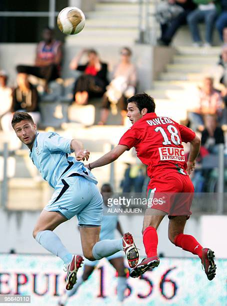 Tours' Olivier Giroud vies with Sedan's Stanislas Oliveira during their French L2 football match Tours vs Sedan at the Louis Dugaugez stadium on May...