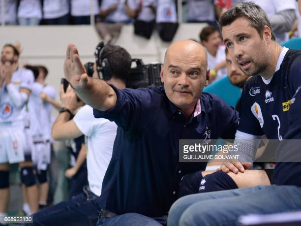 Tours Volley Ball's head coach Giampaolo Medei talks with Tours Volley Ball's French libero Hubert Henno during the CEV Cup men's final between Tours...