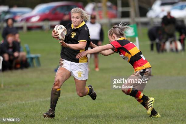 Tove Svanborg of Wellington heads for the wing defended by Hannah Brough of Waikato during the round three Farah Palmer Cup match between Waikato and...