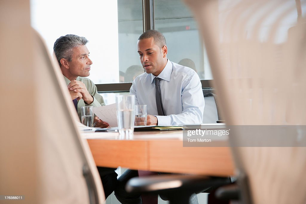 Tow businesspeople in a boardroom : Stock Photo