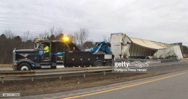 A tow truck prepares to haul away a trailer damaged in an accident in the southbound lane of the Maine Turnpike in Saco on Wednesday February 3 2016