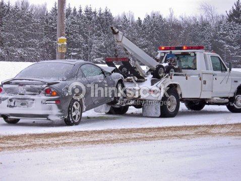 tow truck towing car stock photo thinkstock
