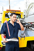 tow truck worker on the phone