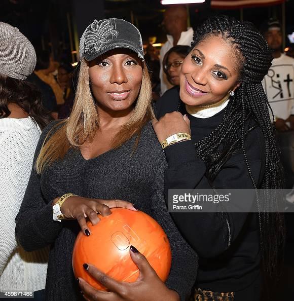 Towanda Braxton and Trina Braxton attend Ryan Cameron Foundation 23rd Annual Family Fun Night at Stars and Strikes on November 27 2014 in Stone...