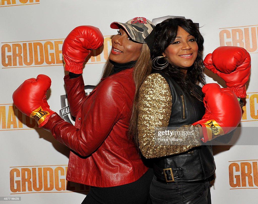 Towanda Braxton and Trina Braxton attend the 'Grudge Match' screening at AMC Parkway Pointe on December 17 2013 in Atlanta Georgia
