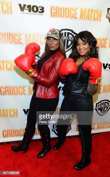 Towanda Braxton and Trina Braxton attends the 'Grudge Match' screening at AMC Parkway Pointe on December 17 2013 in Atlanta Georgia