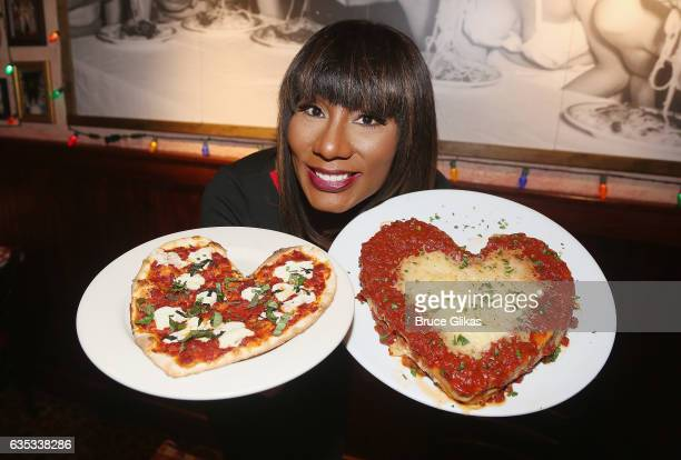 Towanda Braxton pose with the Buca Valentine's Day 'Heart Shaped Pizza' and 'Heart Shaped Lasagna' as she promotes her WE television series 'Braxton...