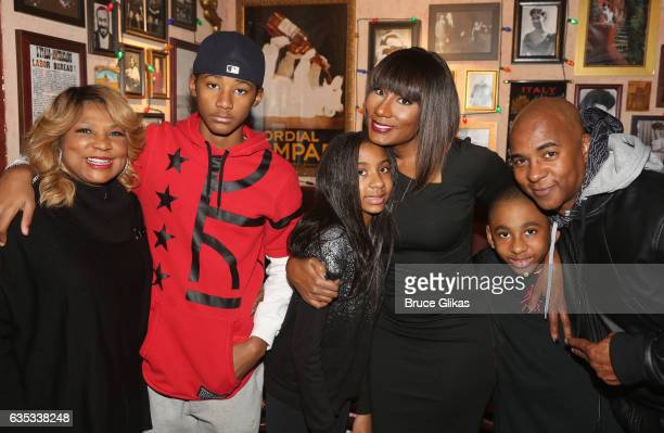 Towanda Braxton poses with her family as she promotes her WE television series 'Braxton Family Values' at Buca di Beppo Times Square on February 14...