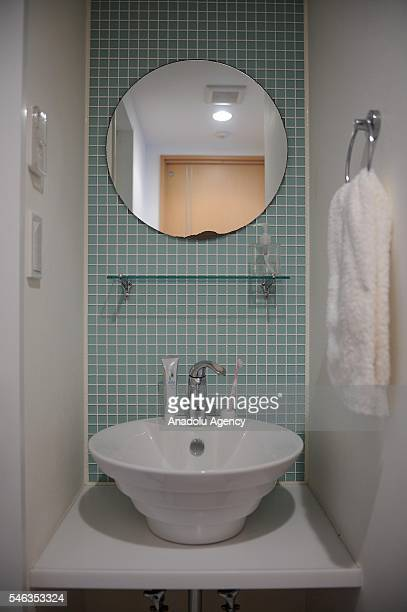 A towel a toothbrush and a tube of toothpaste are seen in the bathroom of minimalist Saeko Kubishiki in Fujisawa Kanagawa Prefecture in the southern...