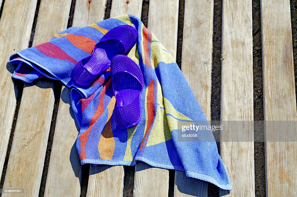 towel and flippers : Stock Photo