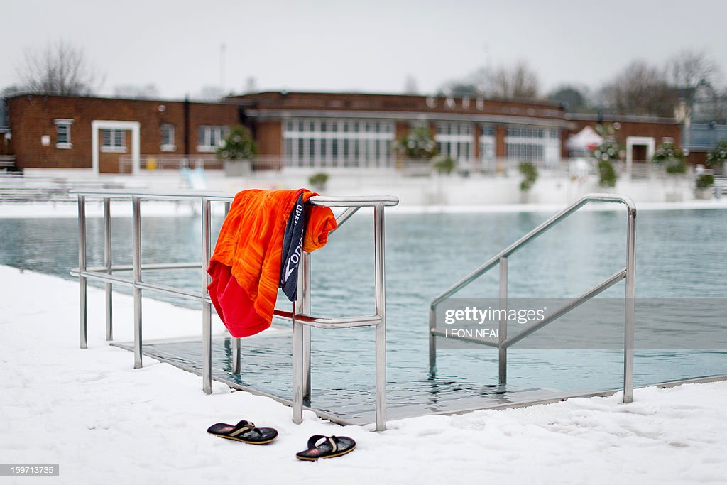 A towel and pair of flip-flop sandals belonging to an open-air swimmer are seen by the water at a lido in north London on January 19, 2013. While some people are savouring the cold conditions, snow that swept across Britain on January 18 continues to cause travel difficulties across the country.