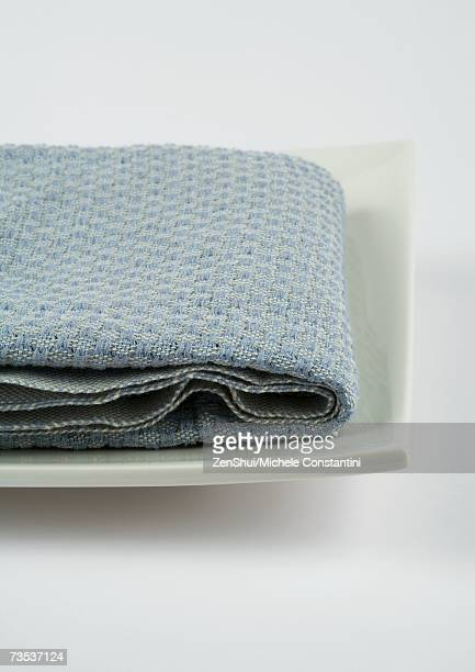 Towel folded on square dish