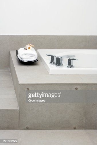 Towel near a bathtub in the bathroom : Foto de stock