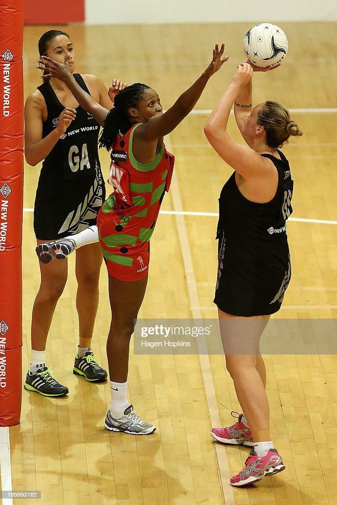 Towela Vinkhumbo of Malawi defends against Catherine Latu of New Zealand during the International Test Match between the New Zealand Silver Ferns and the Malawai Queens at Pettigrew Green Arena on October 27, 2013 in Napier, New Zealand.