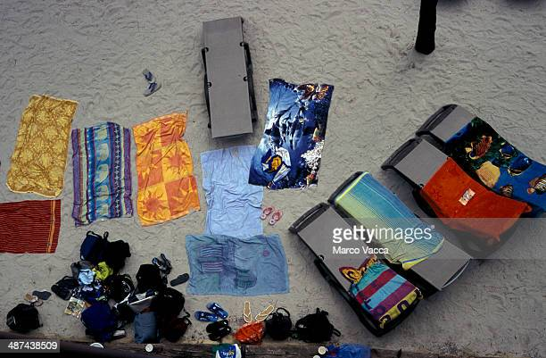 Towels and loungers on the sand