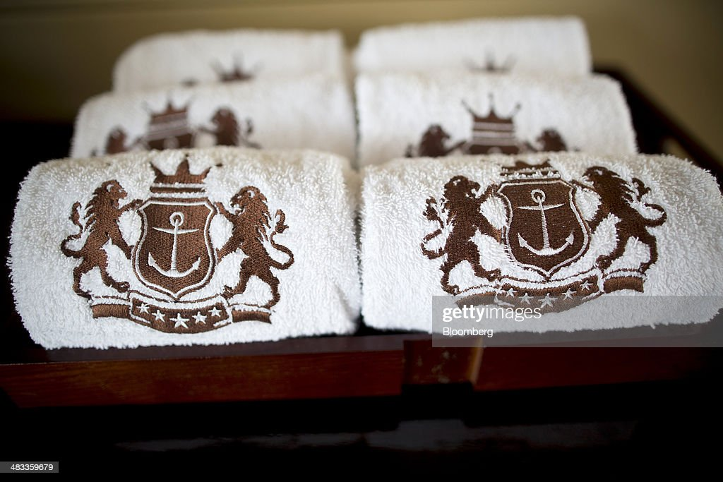 Towels embroidered with the Visun Royal Yacht Club logo sit inside the Visun Royal Yacht Hotel in the Sanya Bay district of Sanya, Hainan Province, China, on Monday, April 7, 2014. The yuan is poised to recover from declines that have made it Asia's worst-performing currency as China seeks to prevent an exodus of capital that would threaten economic growth, according to the most accurate forecasters. Photographer: Brent Lewin/Bloomberg via Getty Images