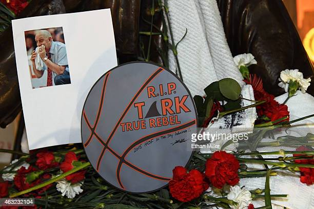 Towels flowers and photos are among items placed at a statue of Jerry Tarkanian outside the Thomas Mack Center at UNLV after a gathering of fans for...