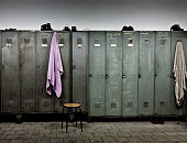 Towels hanging from lockers in locker room