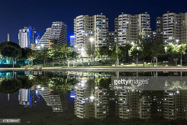 Tower blocks refecting in a pond, Valencia, Spain