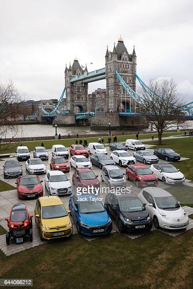 Tower Bridge is seen as 26 alternativelyfuelled vehicles including hybrid plugin hybrid electric and hydrogen cars and vans are displayed during a...