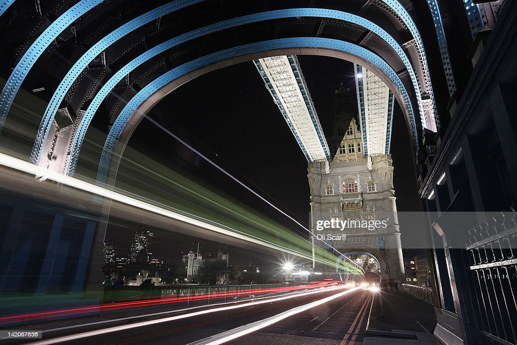 Tower Bridge spanning the river Thames is illuminated at night on March 28, 2012 in London, England.