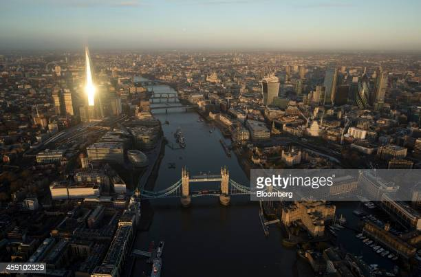 Tower Bridge spans the River Thames as skyscrapers including the Shard Tower 42 the Heron Tower the Leadenhall building also known as the...