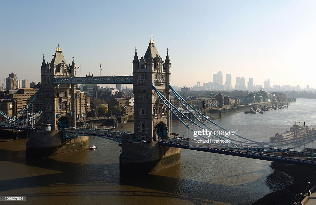 Tower Bridge with Canary Wharf in the distance viewed from the top of City Hall on March 7, 2011 in London, England.