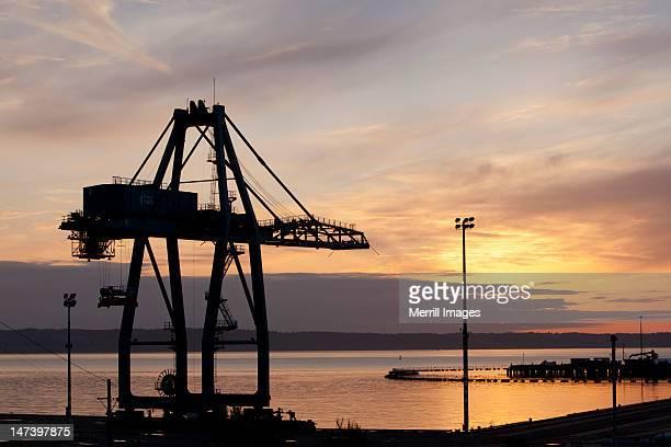 Tower crane at Port at sunset