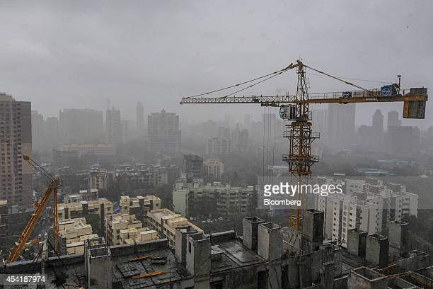 A tower crane operates at a residential construction site developed by Omkar Realtors Developers Pvt in the Parel area of Mumbai India on Friday Aug...