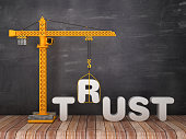 Tower Crane with TRUST Word on Chalkboard Background - 3D Rendering