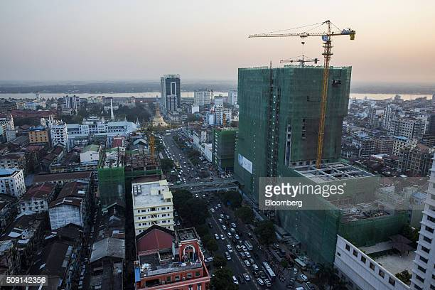 Tower cranes stand at a construction site in Yangon Myanmar on Thursday Feb 4 2016 Aung San Suu Kyi's party assumed control of the nation's...