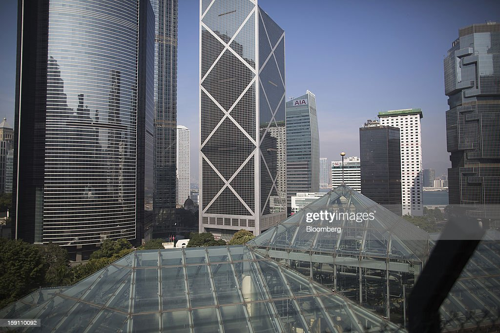 Tower, left, and Bank of China Tower, center, stand behind the Hong Kong Park Conservatory, foreground, in Hong Kong, China, on Saturday, Jan. 5, 2013. Hong Kong topped the ranks as the most expensive office market by total occupancy cost, according to a report by CBRE Research released on Jan. 7. Photographer: Jerome Favre/Bloomberg via Getty Images