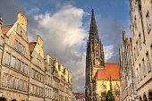 Gables of historical houses and the tower of Saint Lamberti Church in the Prinzipalmarkt street in Munster, Germany