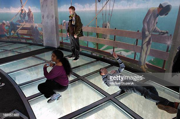 Tower visitors taking self portraits on the glass observation deck Siegfried Rinder on far right floor taking self portrait photos from Austria