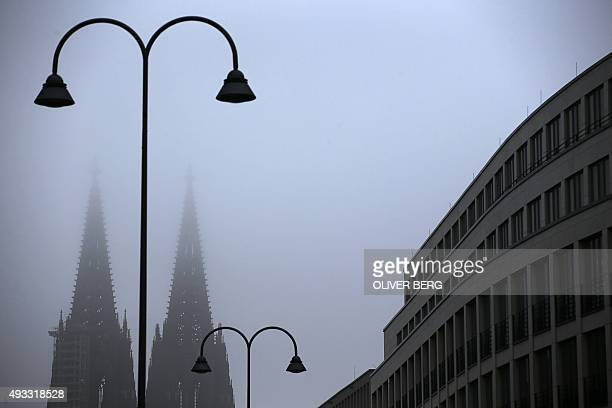 Towers of the Cologne's cathedral are pictured on October 19 2015 AFP PHOTO / DPA / OLIVER BERG GERMANY OUT