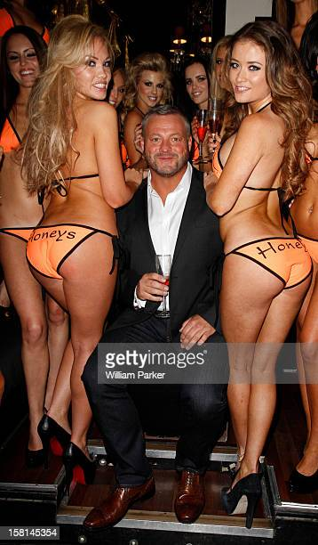 Towie Nightclub Owner Mick Norcross Poses For Photos Alongside His New Entourage In Their Customised 'Honeys' Bikinis At Sugar Hut In Brentwood Essex