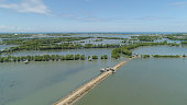 Town in cultivated mangroves, Ubagan, sto tomas. Fish farm with cages for fish and shrimp in the Philippines, Luzon. Aerial view of fish ponds for bangus, milkfish. Fish cage for tilapia, milkfish far