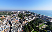 An aerial view over the popular tourist destination of Bournemouth, a seaside town in Dorset. Taken from 500 feet up in a balloon. Wide angle lense used. Logos removed and people too small/indistingui