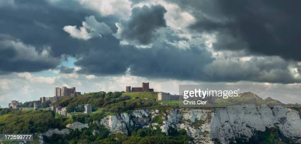 Town built on white cliffs under stormy sky, Dover, Kent, England