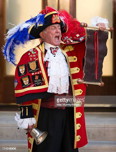 A town crier announces the birth of the son of The Duke and Duchess of Cambridge outside the Lindo Wing at St Mary's Hospital on July 22 2013 in...