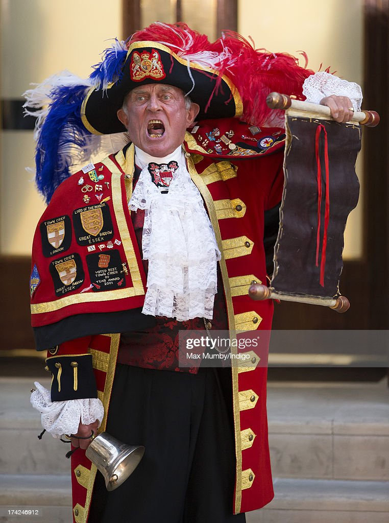 A town crier announces the birth of the son of The Duke and Duchess of Cambridge outside the Lindo Wing at St Mary's Hospital on July 22, 2013 in London, England.